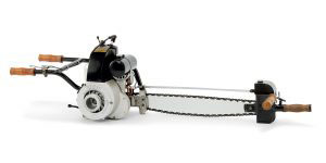 The first two-man petrol chainsaw (46kg/6 hp), introduced in 1929