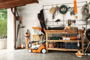 STIHL AK System Range including a cordless chainsaw and cordless lawn mower.