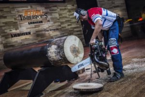 Martin Komarek of Czech Republic tries to fix his chain in the Hot Saw discipline during the 2017 Stihl Timbersports World Championships in Norway