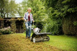 The STIHL MM 56 being used in the garden