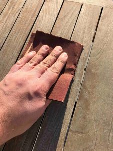 prepare garden furniture for painting using sand paper