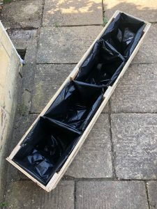 prepare planter liners and punch holes in the base to help with drainage